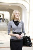 Young Attractive Blond Woman Standing Inside In State Department Store. Shopping. Moscow