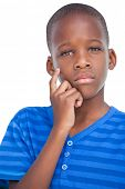 Thoughtful little boy with hand on face on a white background