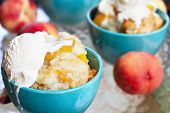 picture of vanilla  - Fresh peach cobbler served with vanilla ice cream - JPG