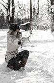 stock photo of ruddy-faced  - Funny teenager girl playing in white snow - JPG