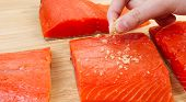 Putting Sea Salt On Red Salmon