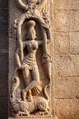 stock photo of tamil  - Hindu goddess on the wall in Mamallapuram Tamil Nadu India - JPG