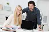 Young Businessman And Woman In The Office