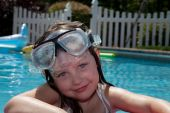 Girl On Pool Float With Goggles
