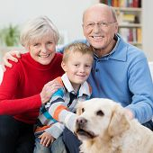Happy Little Boy With His Elderly Grandparents