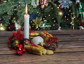 Christmas Cookies And Candle On Wooden Table