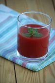 Tomato Juice In Glass And Fresh Mint Leaves On Wooden Background
