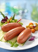 Boiled sausage with greens