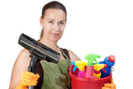image of house cleaning  - A young woman with cleaning equipment ready to clean  - JPG