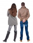 Back view of couple  in jacket. Rear view team people collection.  backside view of person.  Isolate