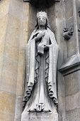 PARIS, FRANCE - NOV 11, 2012: Saint Clotilde statue, Church of St-Germain-l'Auxerr ois founded in the 7th century, was rebuilt many times over several centuries.