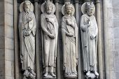 PARIS, FRANCE - NOV 05, 2012: St Paul, King David, a queen, king, architectural details of Notre Dam