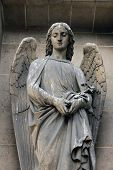 PARIS, FRANCE - NOV 09, 2012: Archangel Gabriel, architectural details of Eglise de la Madeleine. Ma