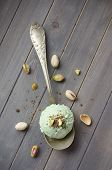 Scoop Of Homemade Pistachio Ice Cream With Chopped Pistachios And Chocolate
