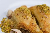 traditional dessert turkish baklava,well known in middle east and delicious isolated on white backgr