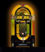 stock photo of jukebox  - Vintage colorful music jukebox against dark background - JPG