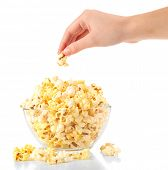 Popcorn in glass bowl isolated on white