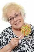 The elderly woman with a sugar candy