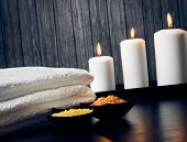 pic of massage oil  - Spa massage border background with towel stackedcandles and sea salt on wood background