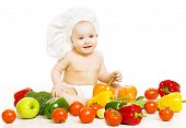 Baby Food. Child In Cook Hat Sitting Inside Vegetable Over White Background. Healthy Meal Concept.