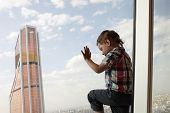 Child And Skyscraper