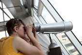 Family Looking Through Pay Binoculars