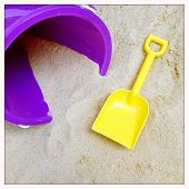 Instagram filtered image of a shovel and pail in the sand