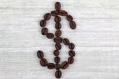 Coffee beans in the shape of Dollar sign