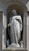 PARMA, ITALY - MAY 01,2014: Statue of saint, San Giovanni Evangelista is a church in Parma, northern