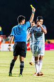 Sisaket Thailand-july 6: The Referee (blue) Show The Yellow Card During Thai Premier League Between