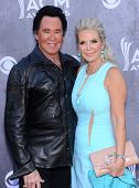 LOS ANGELES - APR 06:  Wayne Newton & Kathleen McCrone arrives to the 49th Annual Academy of Country
