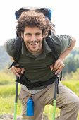 Portrait Of Young Smiling Man Leaning On Hiking Pole Outdoor