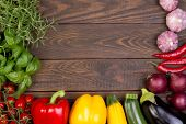 Fresh vegetables on wooden background with copy space