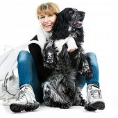 woman with her dog cocker spaniel in a studio isolated on a white background