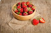 Ripe Strawberry In A Wooden Bowl On The Table