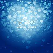 Festive blurred blue background with bokeh