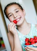 Happy Little Girl Eating Strawberries