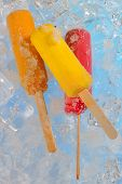 Fruit ice cream pops on ice
