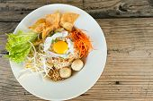 foto of gai  - Gai pad bai gaprow style Thai dish with fried egg and rice noodles - JPG