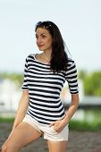 Woman posing in a striped shirt