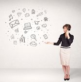 Young business woman presenting hand drawn media icon cloud