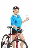 Female cyclist holding a water bottle isolated on white background
