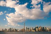 View of Toronto skyline with blue sky over Ontario lake