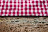 Red Fabric Tablecloth Textile On Wooden Background