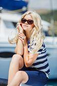 Beautiful young woman near the marina.