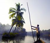 Indian boatman and traditional boat.
