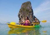 image of kayak  - Young couple sea kayaking - JPG