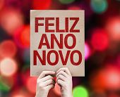 Happy New Year (in Portuguese) card with colorful background with defocused lights
