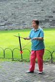 woman juggle in one of parks, Beijing