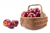 Basket With Red Apples On A White Background